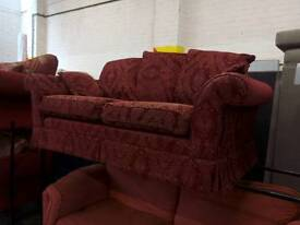 2 seater dark red sofa. Del available
