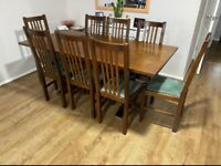 Solid Wood beautiful dining table and 8 chairs for sale