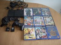 Playstation 2 Slimline with 2 controllers, 2 memory cards and 9 games