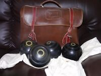 set of 4 outdoor bowls and leather bag..size 3 £20