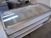 Used and serviced Novum deep chest display freezer with curved glass top