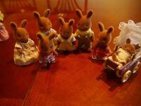 Sylvanian Rabbit family with silver cross baby bunny pram