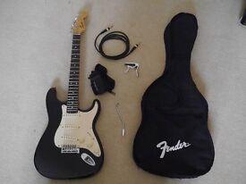 Squier Strat Fender Electric Guitar bundle + case + capo + cable +strap + tremolo