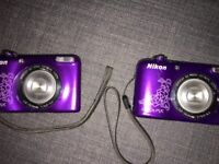 Purple Nixon coolpix cameras