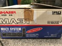 SHARP multi-region VCR. Boxed with instructions and remote.