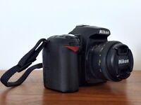 Nikon D90 camera body with SD cards and Nikkor 50mm f/1.8 portrait lens