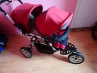 jane tandem/twin pram with foot muffs. will deliver seen add!