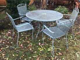 Metal garden and chairs