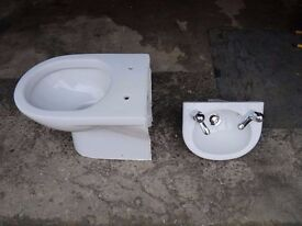 Back to wall toilet and cloakroom basin. C/W taps and clicker waste.