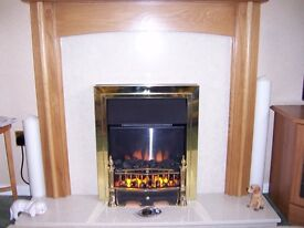 Electric Fire with marfil back and hearth and medium oak mantlepiece
