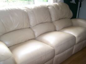 Cream 3 seater leather sofa.