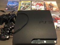 Playstation 3 slim 250gb + 2 controllers + 5 games
