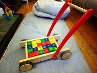 Baby walker with bricks