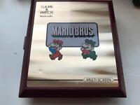 Vintage Nintendo Mario Bros Game & Watch pocket lcd game 1983