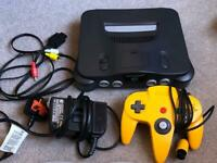N64 nintendo 64 console with yellow pad