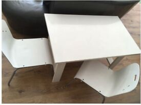White table and two chairs