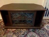 Dark oak effect TV cabinet with glass drop down cupboard