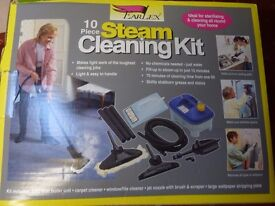 STEAM CLEANER WITH ATTACHMENTS FOR SALE. UNUSED IN THE BOX.