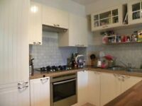 2 bed 2 bath split level with parking included and private garden