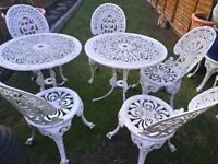 Cast iron garden dining set of 2 tables and 7 chairs