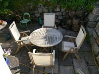 Outdoor good quality hardwood round table and 4 chairs