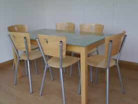 Glass top rectangular table with beech frame and six beech chairs