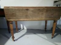 Antique dining table with fold down sides - lovely solid wooden dining table.