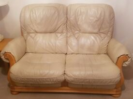 BEIGE COLOURED TWO-SEATER LEATHER SOFA WITH SOLID WOOD FRAME AND SOLID WOOD COFFEE TABLE