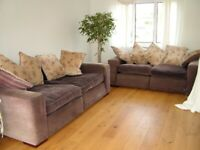 Pair of Very Comfy Sofas with 10 matching cushions.