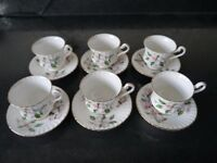 Set of 6 small coffee cups and saucers
