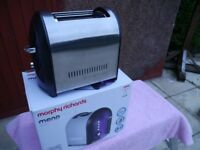 Morphy richards purple 2 slice toaster as new in original box.