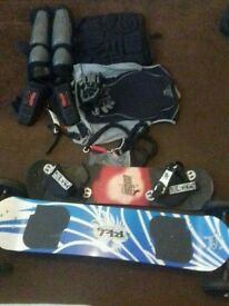 Mountain board with a full set of pads and a spare board with spare springs.