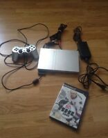 Slim silver PS2 comes with NHL 05