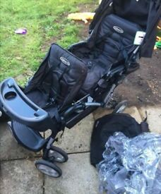 DOUBLE BUGGY WITH RAINCOVERS