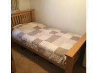 Solid Oak single bed in excellent condition, complete with next-to-new mattress