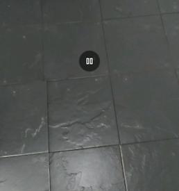 Black textured floor tiles