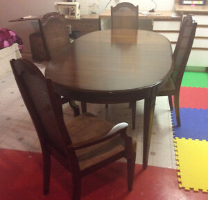 Oval extendable kitchen table with four cane back chairs $125.00