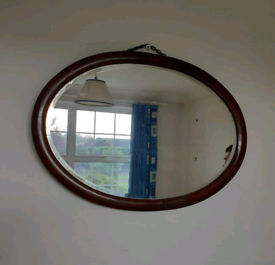 Vintage oval bevelled glass wall mirror,