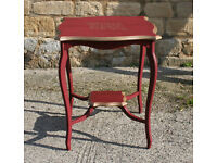 Antique Table Painted in Deep Red with Gold Trim.