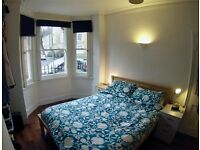 Good sized double bedroom with king size bed in a modernised Kennington flat, 5 mins to the station