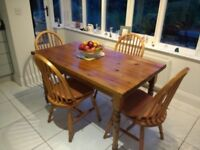 Wooden Table and 4-Piece Chair Set.
