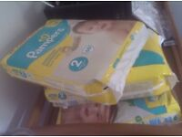 New, unopened Pampers nappies size 2 . Three full packs = 196 nappies