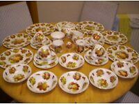 FINE BONE DINNER SERVICE, WHITE PORCELAIN BACK GROUND, WITH VARIOUS FRUIT DESIGNS