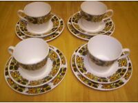 VINTAGE FROM THE 1970'S 12 PC RETRO TEA SET IN WHITE PORCILAIN, WITH RETRO COLORS