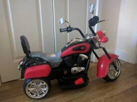 Kids ride on electric motorbike