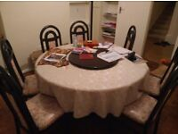 Round 8 seater dining table with chairs and lazy susan - great condition