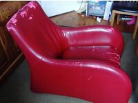Faux leather armchair and footstool, needs re- upholstering