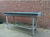 Galvanized steel water bath/trough.