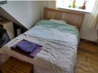 Double wooden bed and nearly new mattress included