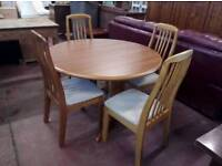 Teak table and chairs in excellent condition
